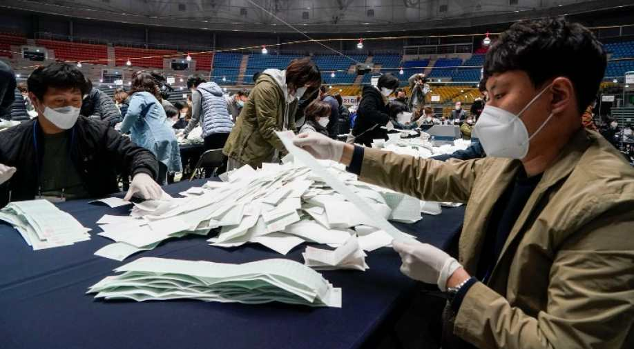 South Korea's ruling party wins election landslide amid coronavirus outbreak