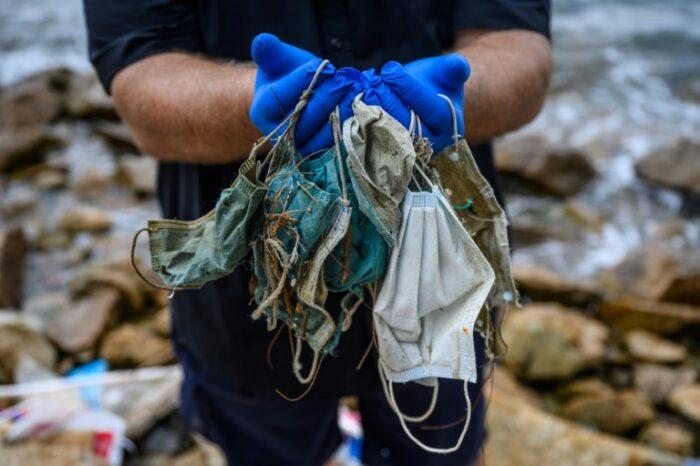 Anti-virus face masks plague Hong Kong's beaches