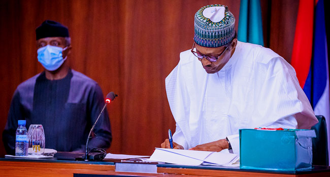 Buhari Signs Revised 2020 Budget Into Law
